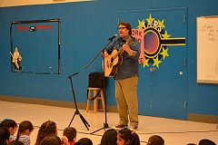 NEWS-TIMES PHOTO: KATHY FULLER - Storyteller Sam Payne entertained students at Echo Shaw Elementary School in Cornelius this morning.