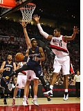 TRIBUNE FILE PHOTO: TROY WAYRYNEN - LaMarcus Aldridge of the Blazers goes up to defend against Memphis Grizzlies point guard Mike Conley in an early-season game at Moda Center.
