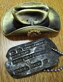TRIBUNE PHOTO: KEVIN L. HARDEN - A small brass Australian Army slouch hat was one of the gifts Tim Hill presented to Lee Gilfeather Parker, daughter of Clarence Gilfeather, whose dog tag Hill returned during an April 18 ceremony. The hat symbolizes the annivesary of the Australian Army's entrance into World War I.