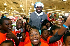 JOE MURPHY/NBAE VIA GETTY IMAGES - Zach Randolph of the Memphis Grizzlies co-hosts a holiday shopping spree for 200 youth from a Boys & Girls Club at Toys R Us. Kids received $100 gift cards to buy presents.