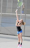LON AUSTIN/CENTRAL OREGONIAN - Greta Harris serves the ball during a match earlier this year. Harris defeated Jessica Gonzalez of Madras 6-0, 6-1 in No. 1 singles action on Monday. However, the Cowgirls had just one more victory in the match as the White Buffalos won 6-2.