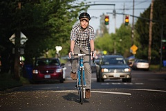 TRIBUNE PHOTO: JONATHAN HOUSE - Cedar Knoll rides down Northeast Dekum Street, near where he collided with a truck a few weeks ago. Im not unique at all, he says. So many people have been hit; theres so much frustration but little they can do.