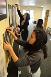 PAMPLIN MEDIA GROUP: VERN UYETAKE - Angela Inama, a West Linn High School senior, hangs a piece of artwork ahead of the April 17 district art show at Arts & Technology High School.