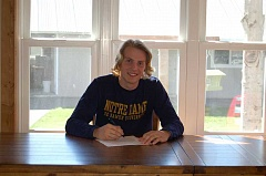 SUBMITTED PHOTO - Justin Eggimann poses for a photo during his letter of intent signing.