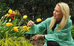 REVIEW, TIDINGS PHOTO: VERN UYETAKE - Despite her incredibly busy life as a Portland TV newswoman, Anne Jaeger always has time to stop and smell the flowers in her backyard.