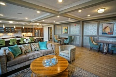 SUBMITTED PHOTO - Community rooms at Portera at the Grove offer space for the 55-and-older residents to gather and relax in style.