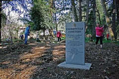 POST PHOTO: KYLIE WRAY - Joyce Yam, right, leads a cleanup at Sandys historic Cherryville Cemetery.