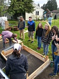 CONTRIBUTED PHOTO - Volunteers spend Saturday, April 18, building raised garden beds for an educational garden at Estacada Assemblies of God Church. Food Waves, a nonprofit organization dedicated to access to healthy food, will train community members at the garden.