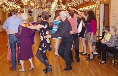 SUBMITTED PHOTO: MADISON GOODALL - Seniors and teens hit the dance floor at Fly Me to the Moon, a golden prom experience organized by the citys Youth Action Council.