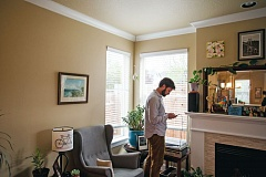 COURTESY: LEAH NASH FOR INVESTIGATEWEST - Justin Buri at his home in the St. Johns neighborhood on a recent April evening. Buri has seen firsthand the pressures of a changing housing market at his job with the Community Alliance of Tenants.