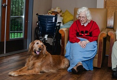 SUBMITTED PHOTO - Joann McCall enjoys a visit from Abbey during a therapy dog visit at the Marquis Autumn Hills memory care center on Beaverton-Hillsdale Highway.