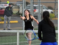 PAMPLIN MEDIA GROUP: SETH GORDON - Tigard High School junior Delaney Shea hits a shot during No. 1 doubles play during the Tigers' match at Newberg on Tuesday. Tigard scored a 6-2 victory.