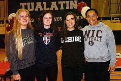 DAN BROOD - Above, Tualatin's (from left) Marissa Lovos, Natalie Anderson, Emily Sorem and Nikki Miller signed their letters of intent last week. Below, Sherwood's Sarah Kotel (left) and Grace McClain sign their letters of intent.