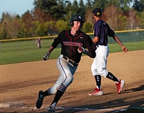 DAN BROOD - Sherwood senior Rich Hekker rounds third base and heads to home during the Bowmen's game with Tualatin.