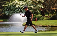 DAN BROOD - Tualatin High School junior J.J. Carter does a fist pump after sinking a long putt on hole No. 18 during Monday's Three Rivers tourney.
