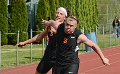JOHN WILLIAM HOWARD - Scappoose senior Joey Krupsky (left) makes the handoff to Braden Clark for the third leg of the 4x100 meter relay on Wednesday, April 22 at Scappoose High School. When they're healthy, all four regular runners on the relay team can run the 100 meters in under 12 seconds.