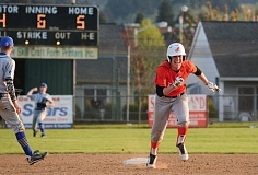 JOHN WILLIAM HOWARD - Scappoose senior Jake Ford runs between second and third during the Indians' win over Valley Catholic on Friday, April 17.
