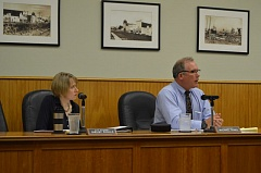 COURTNEY VAUGHN - City Attorney Shelby Rihala (left) and Scappoose City Manager Michael Sykes give feedback to the Scappoose City Council Monday. The council adopted an ordinance to start allowing medical marijuana dispensaries in certain areas within city limits.