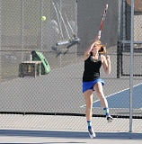 LON AUSTIN/CENTRAL OREOGNIAN - Laura Fraser plays a winner from the back line during the No. 1 doubles match against Philomath, which Fraser and Gwyneth Ptomey won 7-5, 6-3.