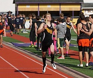 PHOTO COURTESY OF DOUG SMITH - Michael Seyl finishes the final leg of the 4x400 relay at the Prefontaine Rotary Invitational track meet. The Cowboys won the race.