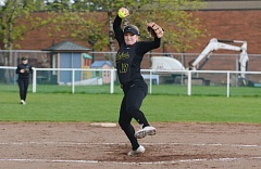JOHN WILLIAM HOWARD - St. Helens senior Mariah Mulcahy throws out a pitch early in the Lions' game with Putnam on April 24. Mulcahy allowed only three hits, but St. Helens fell 3-1.