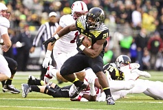 TRIBUNE FILE PHOTO: JAIME VALDEZ - As a freshman in 2014, Royce Freeman led the University of Oregon in rushing.