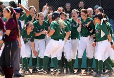 COURTESY OF LARRY LAWSON - The Portland State Vikings greet Brittany Hendrickson at home plate.