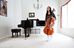 TIMES PHOTO: JONATHAN HOUSE - Annie Zhang carries a specially-made cello worth tens of thousands of dollars.