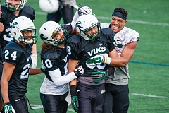 TRIBUNE PHOTO: JOHN LARIVIERE - Portland State defensive back Xavier Coleman is congratulated by Artuz Manning (left), Max Lyons (second from left) and David Jones (right) after making an interception in Saturdays spring football game.