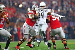 TRIBUNE FILE PHOTO: JAIME VALDEZ - The Ohio State Buckeyes double up on Oregon Ducks defensive lineman DeForest Buckner during last seasons national championship game.