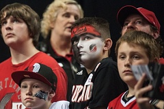 Blazers fans wait for their team to emerge from the tunnel.