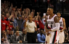 TRIBUNE PHOTO: DAVID BLAIR - Damian Lillard gets fired up after sinking a key basket down the stretch Monday night.