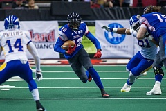 TRIBUNE PHOTO: JOHN LARIVIERE - Jamar Howard, picking up yards after a catch, is likely to miss four to six weeks of the Arena Football League season after the Portland Thunder receiver suffered an MCL injury Saturday at San Jose.