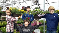 COURTESY PHOTOS: DIANE VAN DYKE - (Left to right) Tiana Rudolf, Aaron Herinckx, Luis Morales, and Zach Keller worked in the greenhouse this year after school, prepping for the annual plant sale.