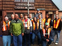 CONTRIBUTED PHOTO - Sixteen volunteers from Timber Lake Job Corps and Estacada Development Association pitched in for the association's annual downtown cleanup Saturday, April 25.