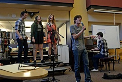 SUBMITTED PHOTO: LIZ RANDALL - Riverdale students honor the late Freddie Mercury with a trilogy of Queen classics (from left): senior Torrin Kelly, sophomore Isabel Pereira, senior Leksi Kostur, senior Nate Pereira singing lead and junior Brian Gentry on piano.