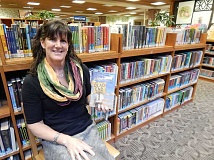 REVIEW PHOTO: CLIFF NEWELL - Andrea Milano wants to make sure every child and teen in Lake Oswego is aware of the amazing collection at the library, including the Newberry Medal-winning book Dead End.