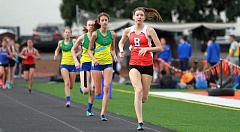 TIMES PHOTO: MILES VANCE - Beaverton's Erin Gregoire leads Aloha's Alyssa Foote during Gregoire's win in the 800 meters at Beaverton High School on Wednesday, April 29.