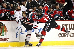TRIBUNE PHOTO: JONATHAN HOUSE - The Portland Winterhawks' Blake Heinrich goes flying in a duel with Dillon Dube of the Kelowna Rockets.