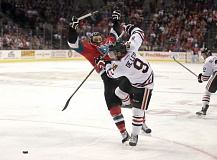 Chase De Leo of Portland battles for the puck in Game 4 versus Kelowna on Wednesday night at Moda Center.