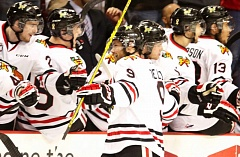 TRIBUNE PHOTO: JONATHAN HOUSE - The Portland Winterhawks bench greets Chase De Leo after his goal gave them an early 1-0 lead in Game 4 against Kelowna on Wednesday.