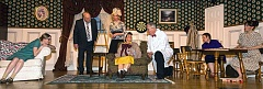 AL STEWART PHOTOGRAPHY - Mask & Mirror Community Theatres production of The Curious Savage includes (from left) Sarah Thornton, Carl Coughlan, Patti Speight, Rebecca Rowland Hines, Gary Romans, Jan Rosenthal and Karlyn Weaver.