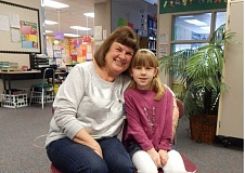 BARBARA SHERMAN - Mary Holland sits with her granddaughter Cali outside the first-grader's classroom, where Holland volunteers one day a week.