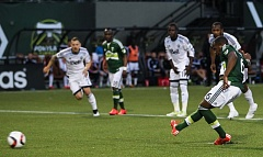 TRIBUNE PHOTO: DAVID BLAIR - Darlington Nagbe sends his penalty kick toward the goal in the 29th minute Saturday at Providence Park. His shot bounced off the post, and the Portland Timbers eventually had to settle for a 0-0 tie with the Vancouver Whitecaps.