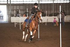 SUBMITTED PHOTO: GREG ARTMAN - Lexee Padrick riding her horse at the final district meet.