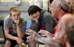 REVIEW PHOTO: VERN UYETAKE - Lakeridge juniors Jacob Krauss (left) and Richard Tuffs are riveted by the wisdom shared by ceramic artist Frank Boyden.