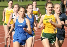 SETH GORDON - Freshman Casey Novak (left) leads a pack of runners in the 800-meter run May 6 during Newberg's four-way home meet versus West Linn, Lake Oswego and Canby. Novak won the event going away with a time of 2:24.68.