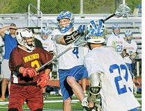 SETH GORDON - Over the top - Jacob Benoit launches himself off the turf to take a shot during Newberg's 9-8 win over Forest Grove May 7. The win ensured a fourth-place finish in the Pacific Conference and a bid to the league tournament.