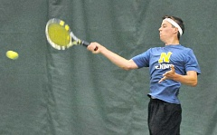SETH GORDON - Power stroke - Newberg senior Nico Bolz rises to smash a forehand during his Three Rivers League district semifinal match Friday at the Portland Tennis Center. Bolz finished fourth in the district to qualify for this week's state tournament.