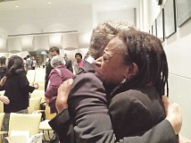 PAMPLIN MEDIA GROUP PHOTO: JENNIFER ANDERSON - Portland Public Schools Superintendent Carole Smith embraces Midge Purcell, advocacy director of the Urban League of Portland following the Urban League's release of the State of Black Oregon.